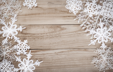 Christmas snowflakes on wooden background