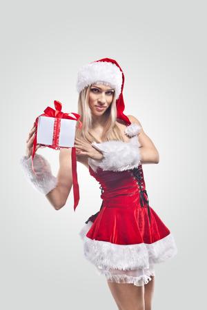 Beautiful woman in Santa Clause costume photo