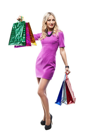 Fashion Sexy Girl full length Portrait   Woman with Shopping Bags isolated on White background  Shopper  Sales  Studio shooting photo
