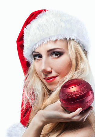 Beautiful  woman in Santa Clause costume with extra long blonde hair  Winter portrait of sexy girl with copy space  Attractive new year and xmas party lady, isolated on white background  photo