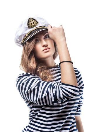 Young Beautiful Adorable Woman in sea peak-cap and stripped vest  Girl - Captain photo