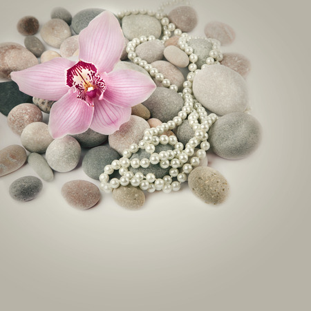 Spa stones, pink Orchid flower and pearls  photo