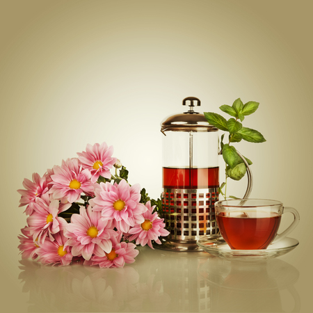 Cup of tea, teapot with mint leaf and beautiful flower Stock Photo