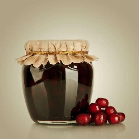 Sweet jam with cherryt and fresh berries. Dessert photo