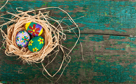 abstract food: Easter eggs in nest on rustic wooden planks. Holidays background Stock Photo