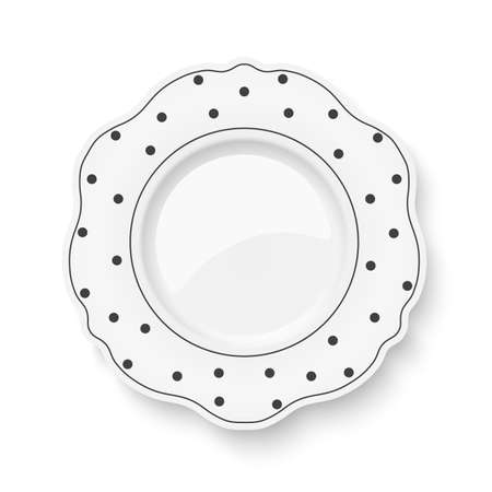 White dish with figured edges and polka dot pattern isolated on white background