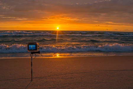 Filming of sunset on the action camera Imagens