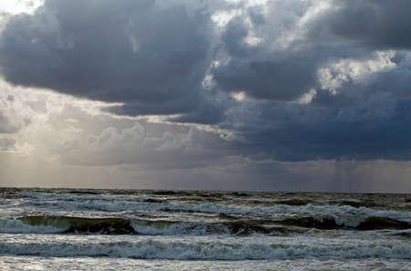 Beautiful evening clouds over the storming Bali Sea Banco de Imagens