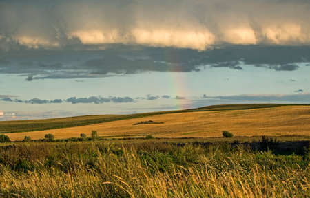 Rainbow over the fields. Agricultural landscape in eastern Lithuania. Banco de Imagens
