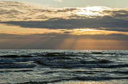 Sunset on the Baltic sea. Water area of the port of Klaipeda, Lithuania. Banco de Imagens