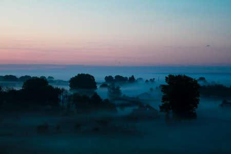 reveille: Sunset landscape. Horizon at sunset. Red black paint