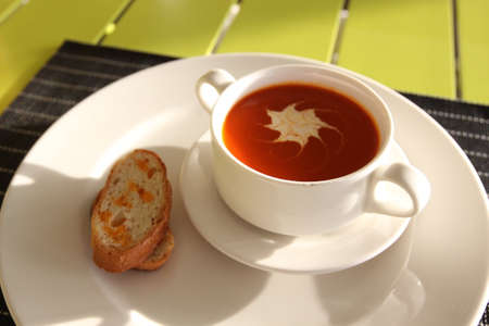Restaurant menu. Dishes which give at restaurants. Soup in the cup Stock Photo