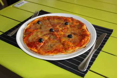 Tasty pizza. Restaurant menu. Dishes which give at restaurants Stock Photo