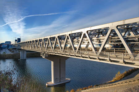 The bridge through the river for the high-speed train. Transport infrastructure. Stock Photo
