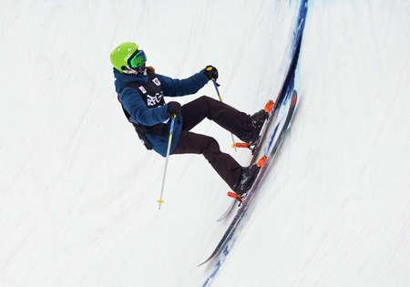 Skiing. Training ride on skis. Winter sport. Editorial