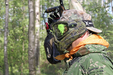 gunfire: Russia, Volgodonsk - June 30, 2015: Paintball. Shooting competition of weapons with paint balls. Forest tournament