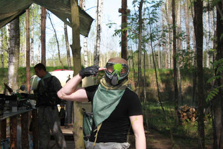 soldiers: Russia, Volgodonsk - June 30, 2015: Paintball. Shooting competition of weapons with paint balls. Forest tournament