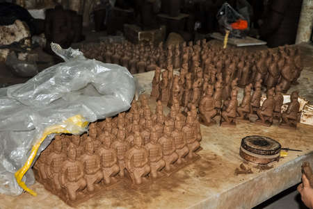 XIAN, CHINA - October 29, 2017: Clay busts in the museum. Souvenir workshop of the terracotta army. Souvenirs in the museum of the terracotta army. Editorial