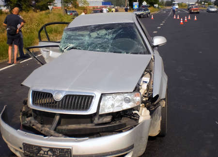 Consequences of a car accident, a wrecked car. Road traffic accident. Editorial