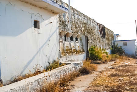 Abandoned US Air Force Base Crete, Greece. Abandoned buildings and structures have fallen into disrepair and are destroyed.