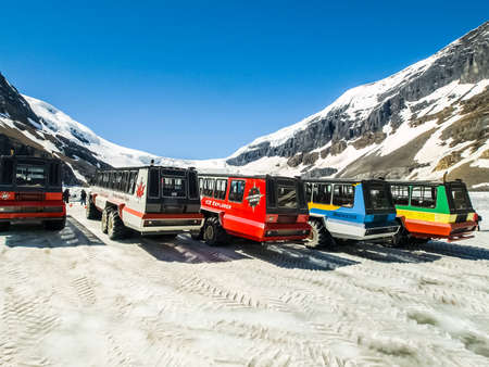 In the mountains of the Cordillera, Canada - March 14, 2017: Buses of all-terrain vehicles in the snow-covered mountains of the Cordillera.