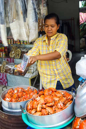Bangkok, Thailand - August 24, 2018: Shop on the market in Bangkok, people sell fruit and seafood.