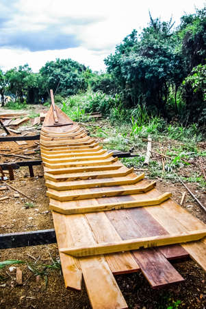 Construction of a new fishing wooden boat in Thailand. Wooden boat