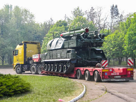 Slavyansk, Ukraine - June 20, 2016: An anti-aircraft missile system BUK, transportation of a combat vehicle through the city to the anti-terrorist operation zone. Transportation through the city of Slavyansk. Editorial