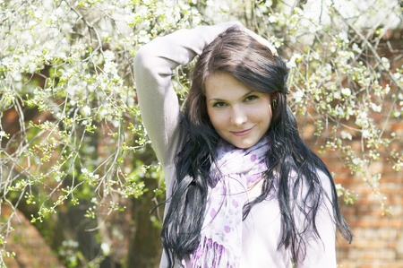 Beautiful girl in a flowering garden photo