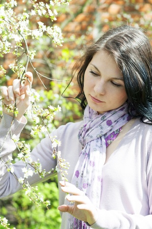 Beautiful girl in a flowering garden photo
