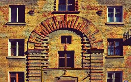 many windows: Brick wall texture in mystical old house with many windows (abstract background, vintage, grunge - concept)