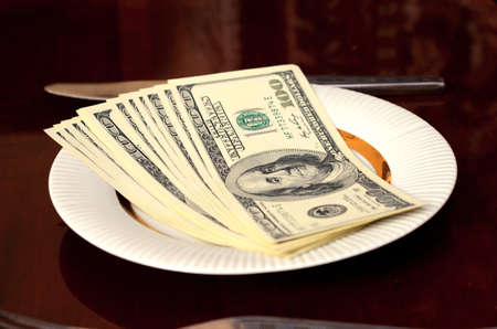 revaluation: Dollars on a plate (loans, financing, financial hunger - concept)