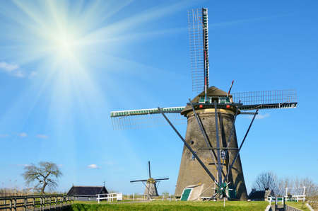 holland landscape: The picturesque landscape with aerial Mill on the channel in Kinderdiyk, Holland on a sunny day