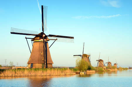 The picturesque landscape with aerial mills on the channel in Kinderdiyk, Netherlands Editorial