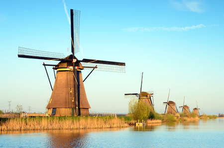 The picturesque landscape with aerial mills on the channel in Kinderdiyk, Netherlands