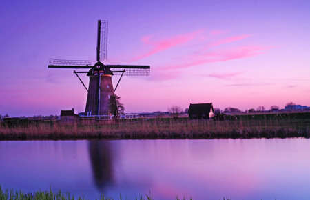 holland landscape: The picturesque landscape with aerial Mill on the channel in Kinderdiyk, Holland at sunset