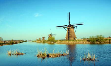 zaan: The picturesque landscape with aerial Mill on the channel in Kinderdiyk, Netherlands Stock Photo