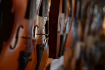 violins: Violins with strings close up Stock Photo