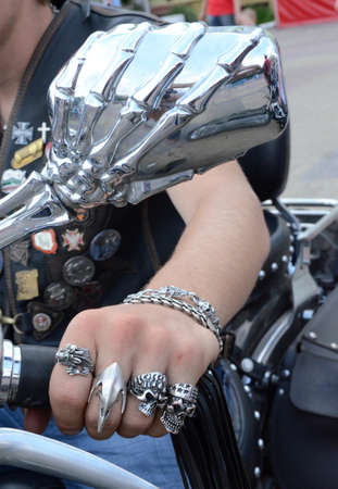 distinctive: Biker hand  closeup with distinctive ring and mirror in the form of a skeleton
