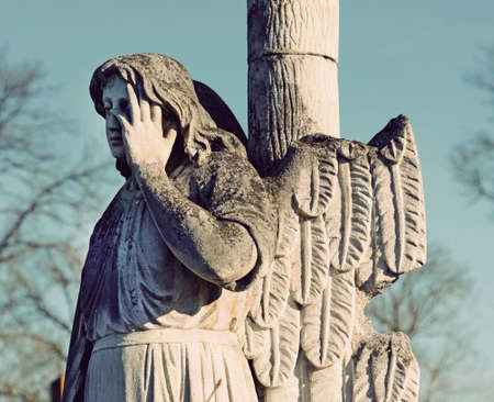 angel headstone: The old stone statue of an angel headstone in the cemetery in vintage style Stock Photo