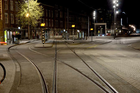 diverge: Abstract cityscape with tram tracks on the road in Amsterdam, Netherlands Stock Photo