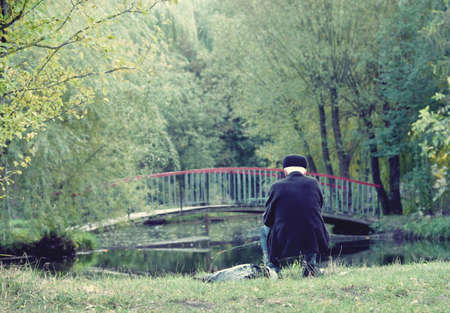 retirees: Retirees fishes in nature (loneliness, old age, pension - concept)
