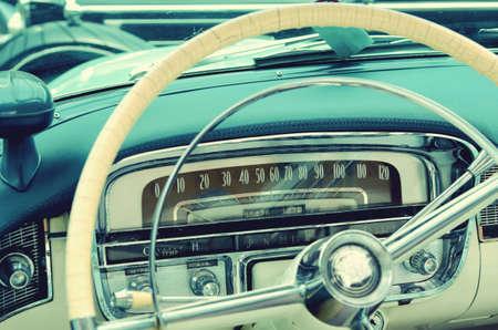 prestige: Interesting beautiful design of retro car with original wheel driving and the sensors. Elegance. Prestige. Vintage style.