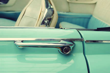 headrest: Door handles in vintage cars. Retro car. Elegance. Prestige. Vintage style. Stock Photo