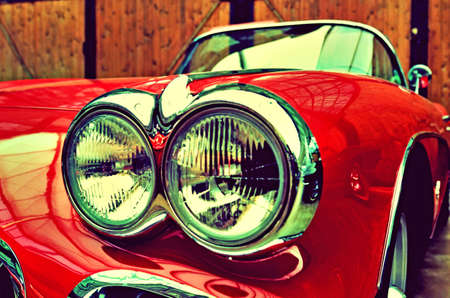 The original double headlights in an old car close up. Elegance. Prestige. Retro style.