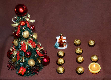 christmas motive: Christmas motive with tree and candy and figure 16 (2016, New Year card - concept). Stock Photo