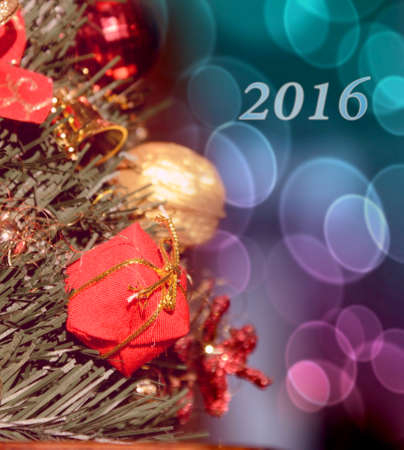 christmas motive: Christmas motive with gift for spruce branch (2016, New Year card - concept). Stock Photo