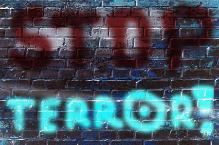 victim war: The inscription on the wall of graffiti with the slogan Stop terrorism (acts of terrorism, threat - concept)