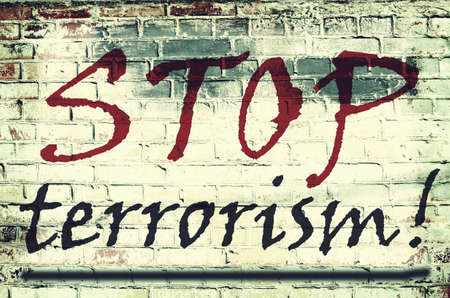 victim war: The inscription on the wall with the slogan Stop terrorism (acts of terrorism, threat - concept) Stock Photo