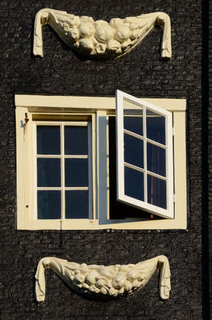 stucco facade: Beautiful close-up window with stucco facade in Amsterdam, Netherlands